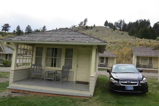 Budget cabin exterior note cozy porch and easy parking for Mammoth hot springs hotel cabins