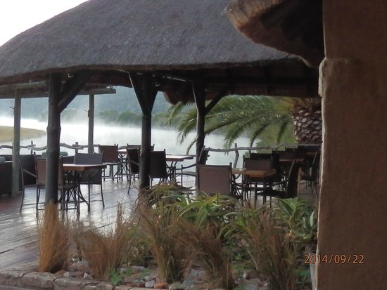 Kariega River Lodge: outside eating area, with views of the Bushman river