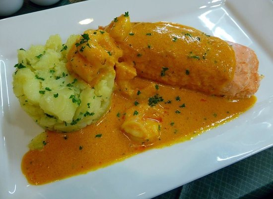 ... salmon fillet crushed new potatoes & a rich tomato and prawn sauce