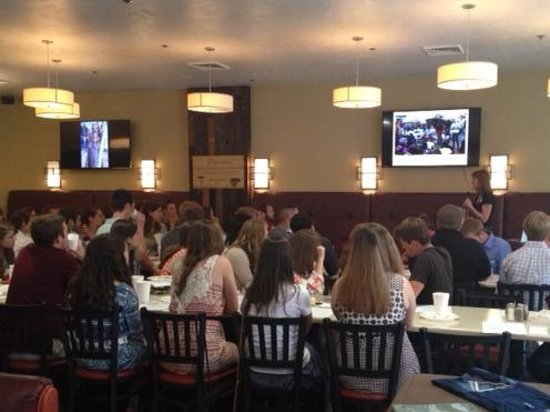 Big screens throughout the restaurant make presentations easy for An new world cuisine cary nc