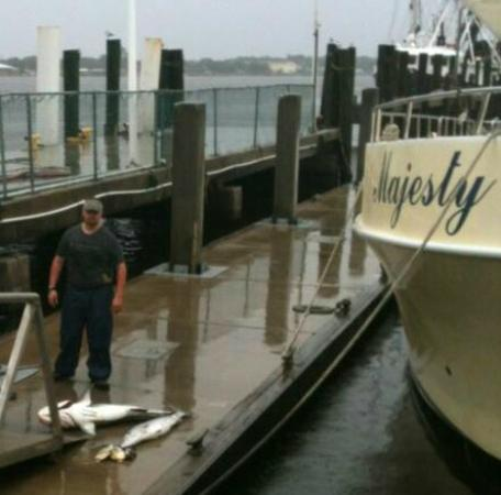 Me standing on the dock by the majesty and my catch for for Majesty deep sea fishing