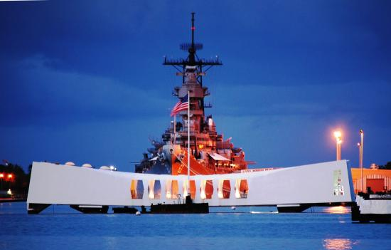 Battleship Missouri standing watch over the fallen USS Arizona.