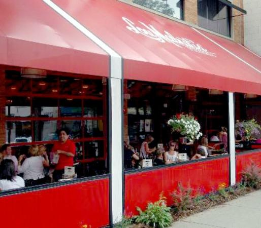 Lou Malnati's, repeatedly voted one of Chicagoland's favorite pizza, is conveniently located right in the heart of Downtown Naperville. Located in Naperville's historic original firehouse, Lou Malnati's offers dining – both indoors and out, bar, large dining rooms and private dining too for groups.