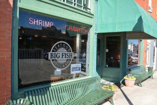 Signage on front window picture of big fish seafood for Big fish restaurant