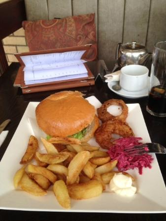 Belton, UK: The house burger, with onion rings, chips and celeriac slaw