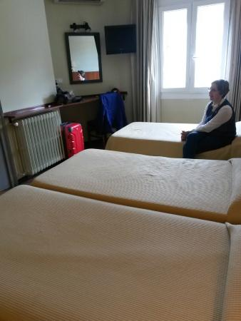 My Large Bed And My Tiny Chair Which In Spite Of Its Size Was Comfortable Picture Of Hotel