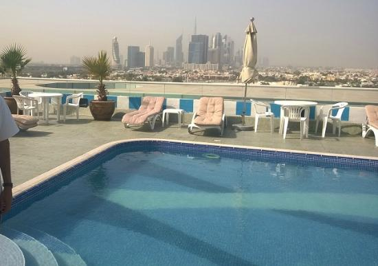Winchester Hotel Apartments: Dubai Skyline and the roof top Swimming pool.
