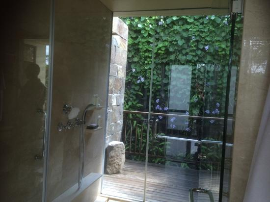indoor then outdoor shower picture of komaneka at