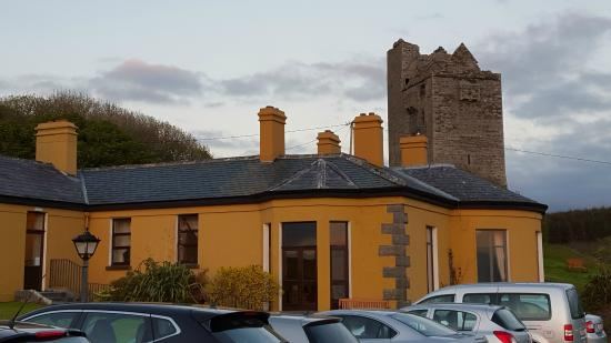 Ballinalacken Castle Country House: Hotel with ruins of castle in background