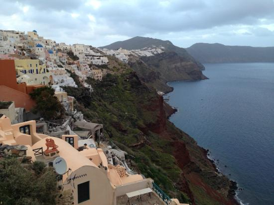 View looking back at Old Oia Houses from the sunset lookout point