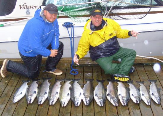 Dockhand shawn and captain al show off the results of for Captain al fishing