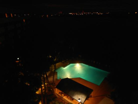 DoubleTree Suites by Hilton Tampa Bay: Evening view. Lit pool/pavilion & lights across the bay.
