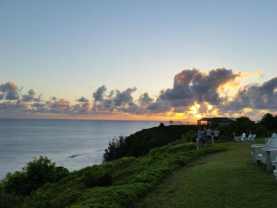 Cliffs at Princeville: View of sunrise from adirondack chair