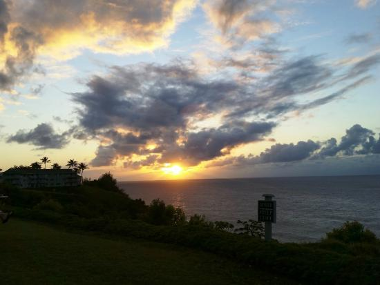 Cliffs at Princeville: View of sunset from adirondack chairs