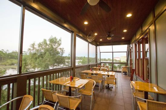 Outdoor patio overlooking lake allen picture of stinky 39 s for Stinkys fish camp