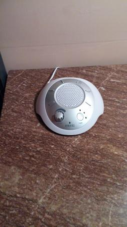Olivier House: White noise machine on bedside table