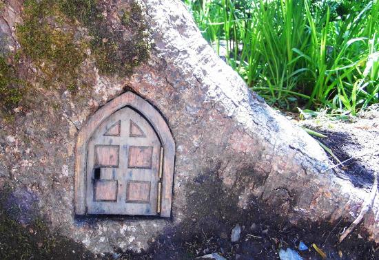 Lydford, UK: A fairy door in one of the trees