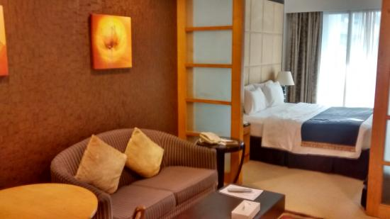 Savoy Suites Hotel Apartments: Sitting area as well as the Bed room with proper arrangment of partition