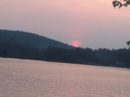 Sunset from our cabin picture of lazy e motor inn weirs for Lazy e motor inn laconia nh