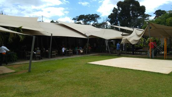 Outdoor serving area picture of zen garden restaurant for Pool garden restaurant nairobi