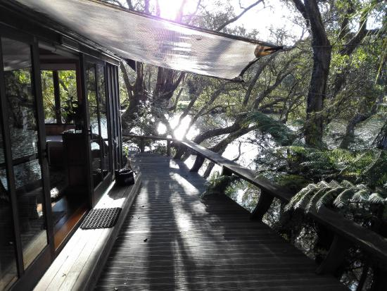 Secluded deck picture of magic cottages at takou river for Absolute bliss salon and retreat
