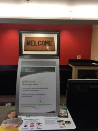 Extended Stay America - Boston - Waltham - 32 4th Ave.: The Sign Placed at the Front Desk As 20 of Us Waited in Line in the Lobby