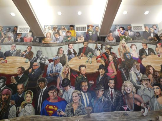 Seating next to mural picture of chatham orpheum for Cape cinema mural