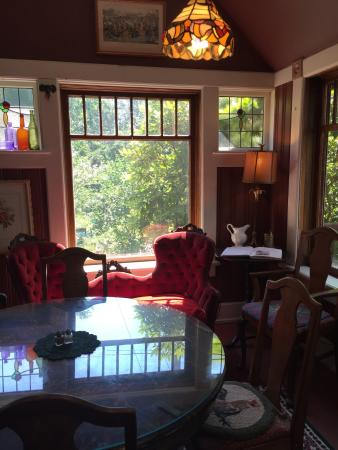Inn at Orchard Heights: Lovely Victorian home with gardens a small greenhouse and antiques for sale.