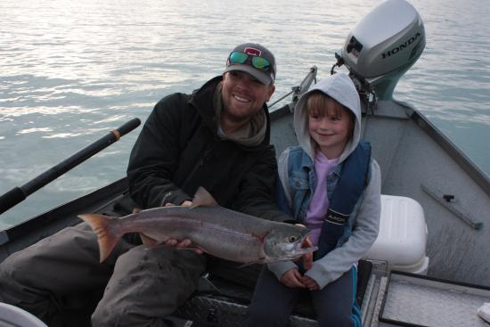 Our fishing guide and one of the nine salmon we caught for Cooper landing fishing guides