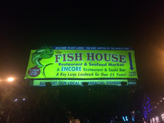 Fish house billboard at night for Fish house key largo