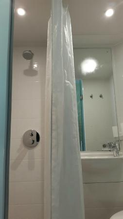 Tune Hotel - Westminster: shower curtain just hangs in the way