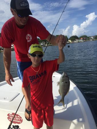 Might not be the biggest but he caught one before i did for Inshore fishing destin fl