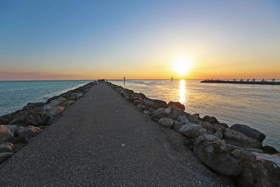 Jetties in Venice offer a different perspective of sunsets over the Gulf.