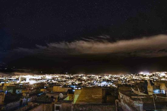 Riad Dar Bensouda: View from the roof at night overlooking the city of Fes