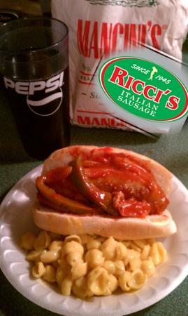 McKees Rocks, PA: Ricci's Italian hot sausage on mancini w/peppers and oninons