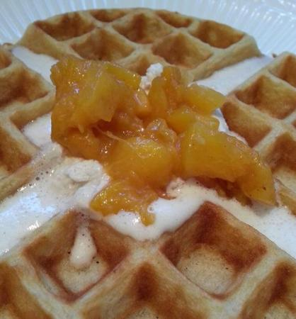 The Inn at Hans Meadow Bed and Breakfast: The waffle today was a peach waffle topped with a spiced whipped cream and sautéed gingered peac