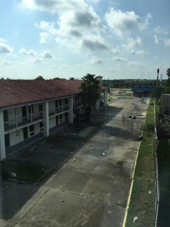 Holiday Inn Express New Orleans East: Abandoned motel next to  hotel pool