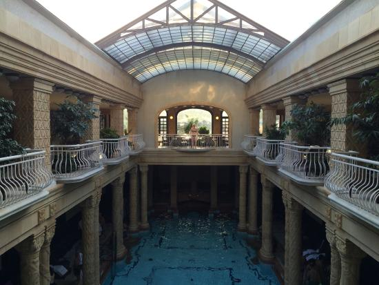 Main outdoor pool picture of gellert spa budapest for Indoor pool with retractable roof