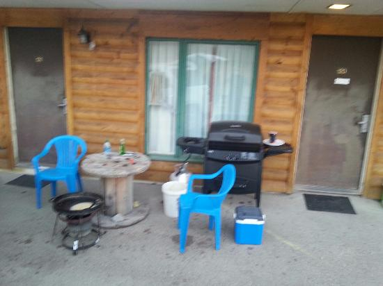 Lusk, WY: table outside of our room, old solid grease in the grill, box knife and other tools laying aroun