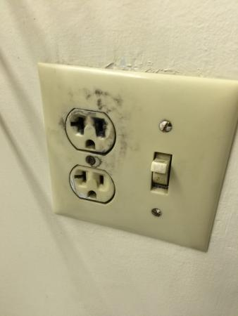 Lexington, MO: bathroom outlet with obvious issues!