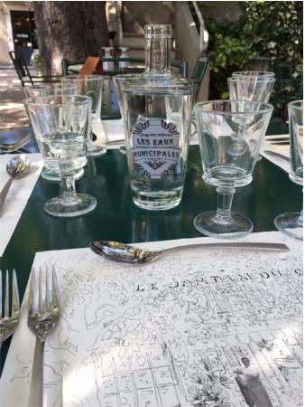 Table sitting with drinking natural local waters picture for Le jardin du quai