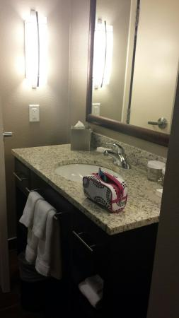 Very clean picture of homewood suites by hilton calgary for Trisha hotel bathroom photos