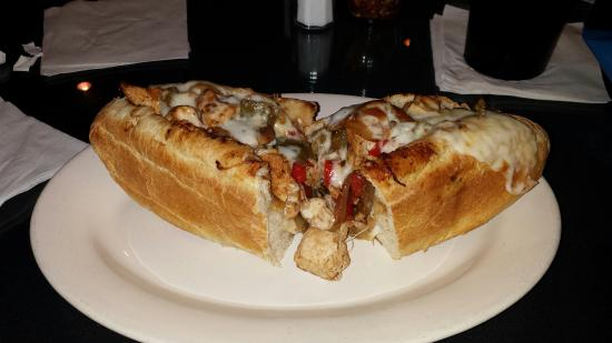 Longs, SC: Scrumptious Chicken with stir fried Onion & Peppers on crispy Home Baked roll & Melted Cheese. N