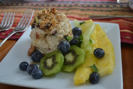 East Orleans, MA: Bircher muesli,topped with toasted granola and fresh pineapple, kiwi and blueberries
