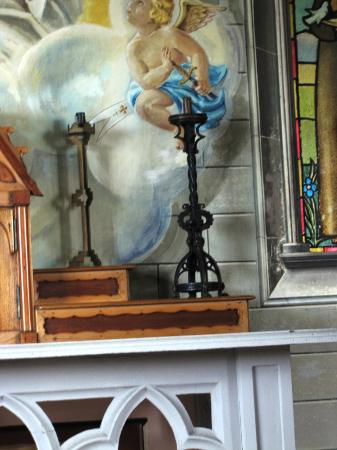 St. Mary's, UK: The candle holder on the laft is from a spent shell casing, the right from a swunken ship deck r