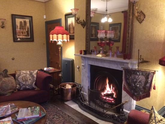 Presteigne, UK: The splendid Victorian drawing room with a roaring open fire
