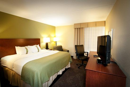 Fairmont, MN: King Bed Guest Room with desk/office chair and lounge chair.