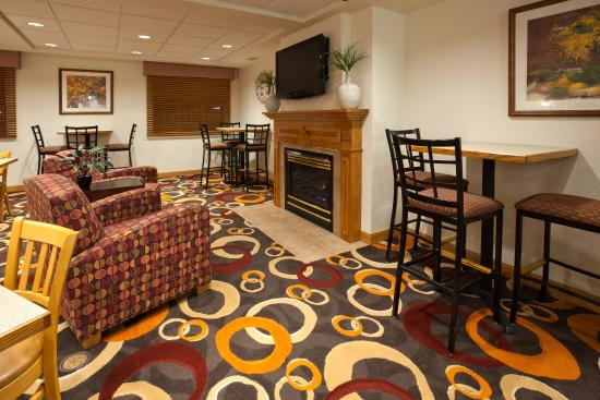 Worthington, MN: Cozy up to our fireplace with a good book!