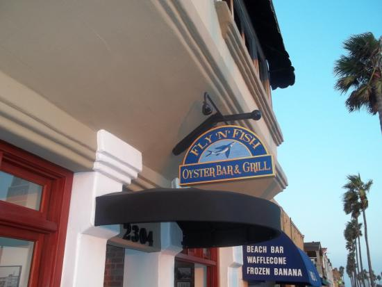 Logo picture of fly n fish oyster bar and grill newport for Flying fish bar and grill
