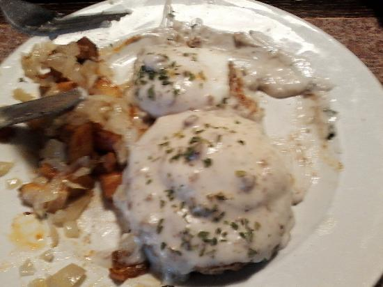 Swanzey, NH: Sausage gravy over egg, sausage patty and biscuit with home fries